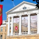 Banners celebrating 100 years of the Wisconsin Idea adorn the exterior of Bascom Hall at the University of Wisconsin-Madison on Aug. 5, 2011. (Photo by Bryce Richter / UW-Madison)